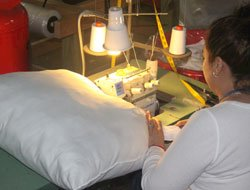 Sewing a pillow in our shop